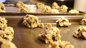 Baking my famous chocolate chip cookies. Can y...
