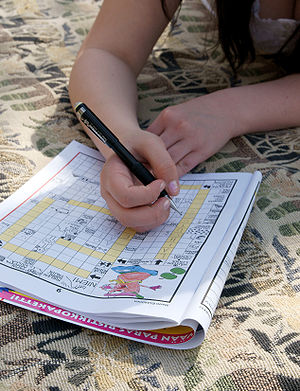 A person making crossword puzzles.