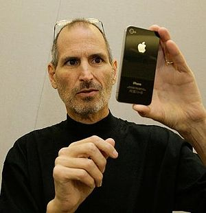 Apple director Steve Jobs shows iPhone
