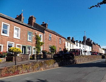 English: View of St Bees Main Street, where it...