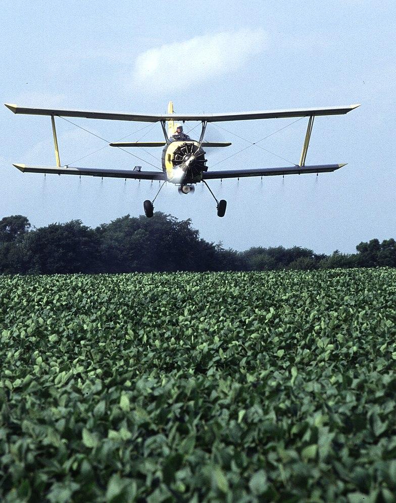 Crop Duster pilot Zumwalt spraying soy beans