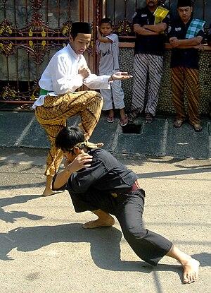 Pencak silat Betawi style performed during Bet...