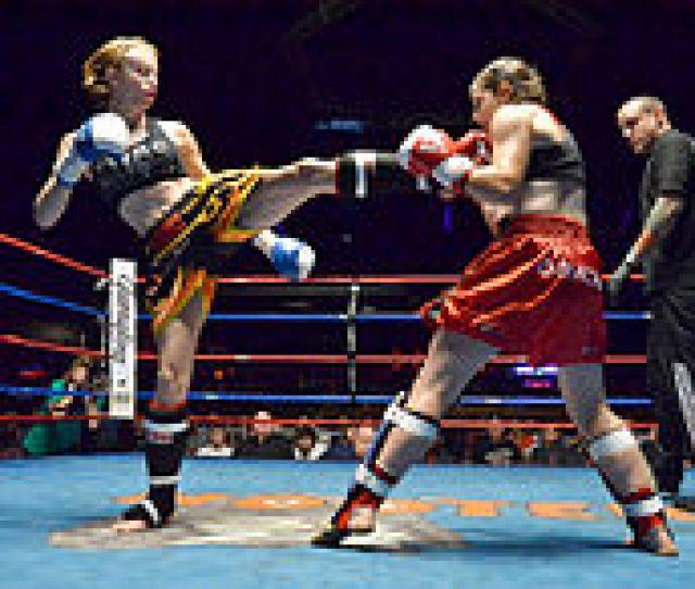 Muay Thai Boxer Delivering A Kick
