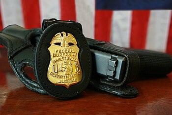 FBI Badge & gun.