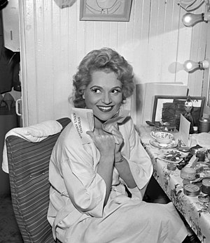 Actress Judy Holliday clutching telegram in he...