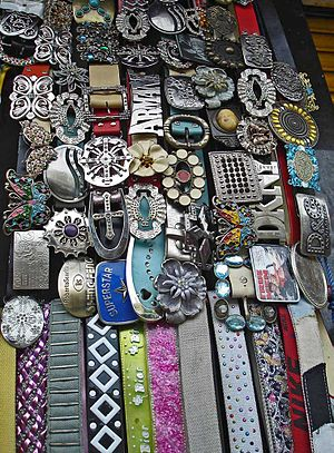 A shop selling a wide variety of belts with pl...