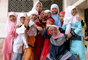 Muslim girls at Istiqlal Mosque in Jakarta pos...