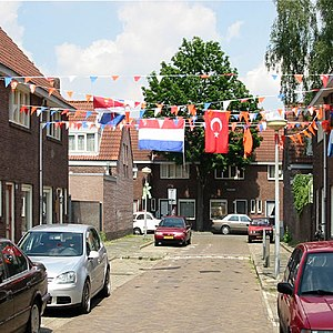 English: Turkish and Dutch flags hanging side ...