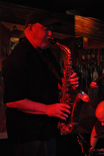English: Saxophonist performing with drummer C...