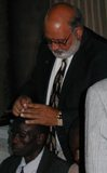Evangelist anointing with oil in Kenya, Africa.