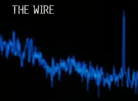 "The words ""The Wire"" in white lettering on a black background. Below it a waveform spectrum in blue."