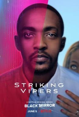 Anthony Mackie, as Danny, looks forward with a neutral expression. Danny's wife Theo holds him from behind, only part of her face visible. The screen is divided between red and blue halves, evoking a video game palette.
