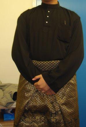 A traditional Baju Melayu worn with songket