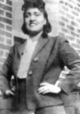 A black-and-white photo of Lacks smiling