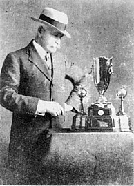 Sir Macpherson Robertson with the winners trop...