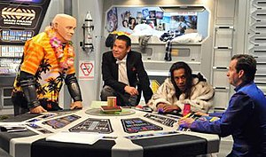 From left to right: Kryten, Lister, Cat, and R...