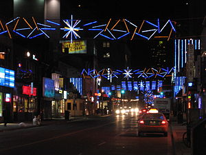 Christmas lights span Yonge Street near Gerrar...
