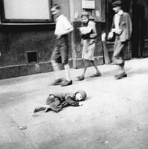 A child dying in the streets of the Warsaw Ghetto