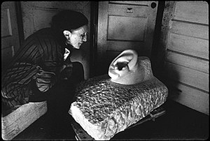Louise Bourgeois with her sculpture To Fall on...