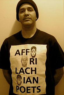 Ricardo Nazario y Colon wearing original Affrilachian Poets shirt - image from Wikipedia article