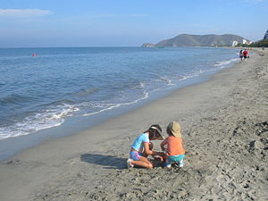 Kids playing in the beach in Santa Marta