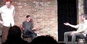 Three improvisers performing long form improv ...