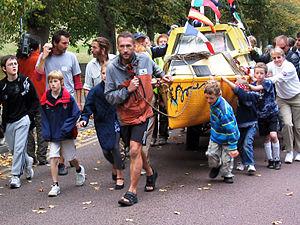 Jason Lewis (centre) arrives at Greenwich, Oct...