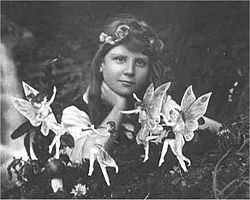 Elsie Wright, a girl from Yorkshire, surrounded by fake fairies, 1917