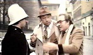 Tognazzi (right) attempting to confuse a traff...