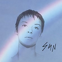 "A blue field with a rainbow across it and a black outline of Chan Marshall's face, with the word ""SUN"" in the right bottom corner in black"
