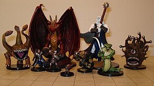 Several Dungeons & Dragons miniature figures. ...