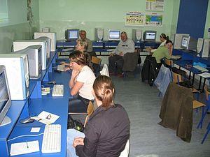 Internet training taking place in an public in...