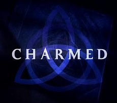 "a dark blue triquetra over a darker blue background that fades to black near the edges with the word ""charmed"" in capital letters across the center using a light-blue, medium-sized font"