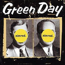 "Two black and white pictures of men in suits and ties are placed side by side with a beige-colored outline atop a black background.  The men's faces are obscured by two yellow circles inscribed with the phrase ""nimrod."" At the top of the image, ""Green Day"" is written in white lettering."