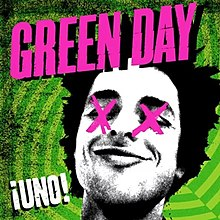 "It features a black-and-white cutout of Billie Joe Armstrong's head, with his eyes crossed-out with pink X's, on a geometric, neon electric green background. The word ""Green Day"" is loudly splashed in pink across the top of the cover, while the word ""¡Uno!"" is sprawled graffiti-style in white in the lower left-hand corner."