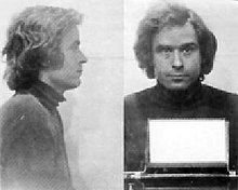 Bundy is facing right in the first photo and facing front in the second. He has medium long hair and is wearing a turtleneck sweater.
