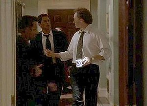 Sam Seaborn and Josh Lyman converse in the hal...
