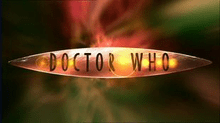A geometrical symmetric lens shape with the words Doctor Who in all-caps flying through green and red wormhole effect.