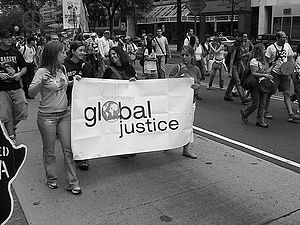 Students march with Global Justice.