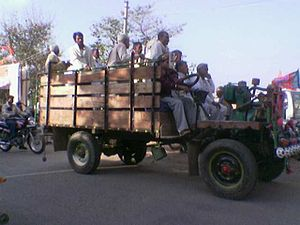 A Jugaad carrying passengers to a political rally