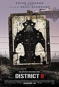 On dirty dusty ground a black and white target practice poster of a bipedal insect-like creature stands, riddled with bullet holes. Barbed wire runs behind the poster and a large circular spaceship hovers in the background.