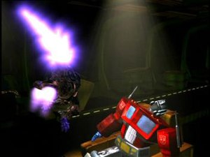 Megatron attacks Optimus Prime in a clash of g...