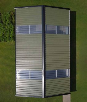 drone aerial photography production of skyclad steel frame garden shed in westmeath