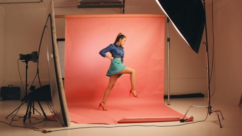 young woman in a photography studio getting a photoshoot