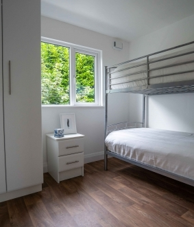 skyclad homes bedroom with bunk beds photography production