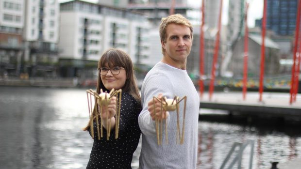 jess kelly and will brightling holding a spider award