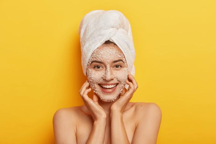 Woman With Face Scrub On Skin Smiling Source Wayhomestudio Freepik