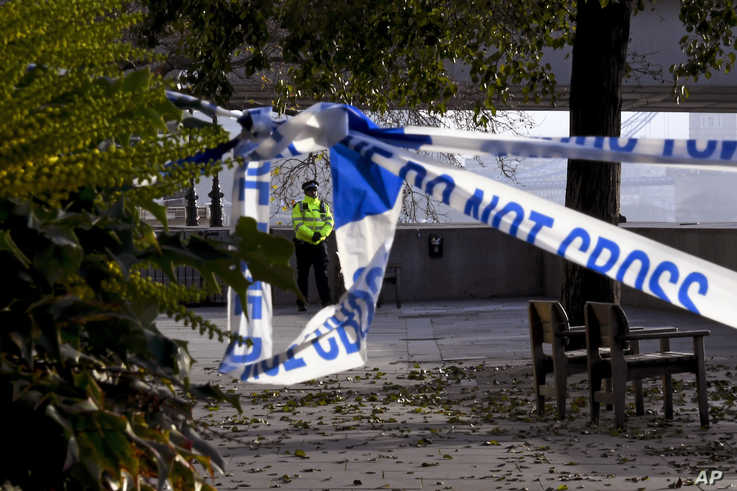 A police officer patrols around the site of the deadly stabbings at London Bridge, in London, Saturday, Nov. 30, 2019. UK…