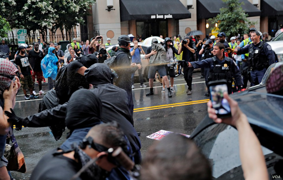 Police officers use pepper spray towards counter-demonstrators during a white nationalist-led rally marking the one year anniversary of  the 2017 Charlottesville 'Unite the Right' protests, in Washington, U.S., August 12, 2018.