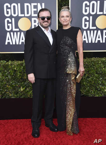 Ricky Gervais, left, and Jane Fallon arrive at the 77th annual Golden Globe Awards at the Beverly Hilton Hotel on Sunday, Jan…